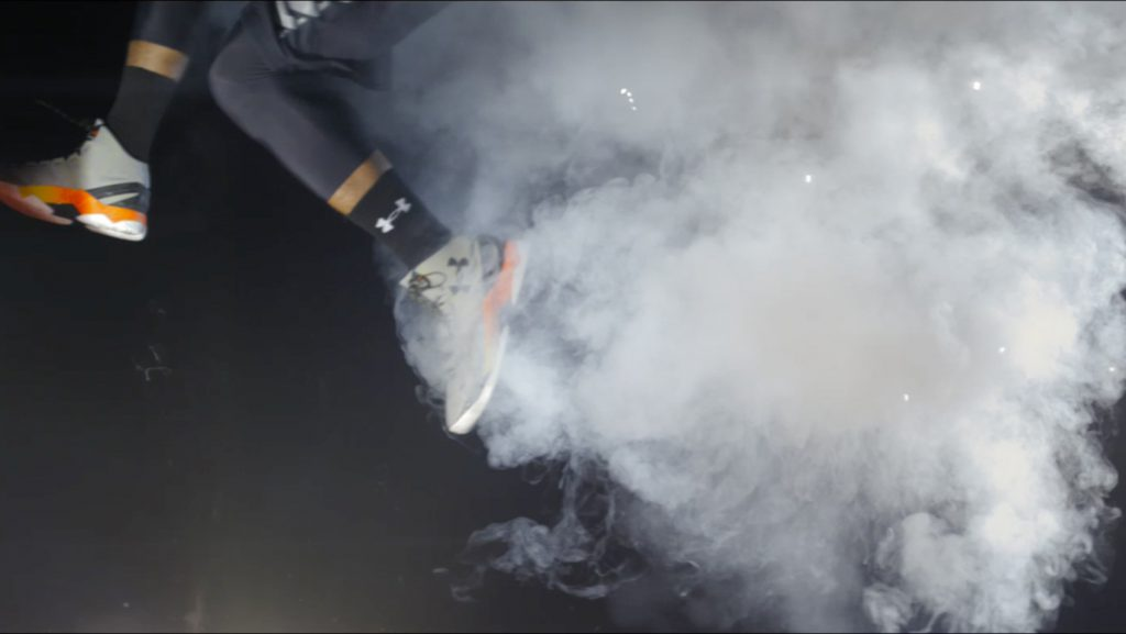 An athlete's feet leave the frame in a cloud of smoke in a still from UnderArmour's Flash ad