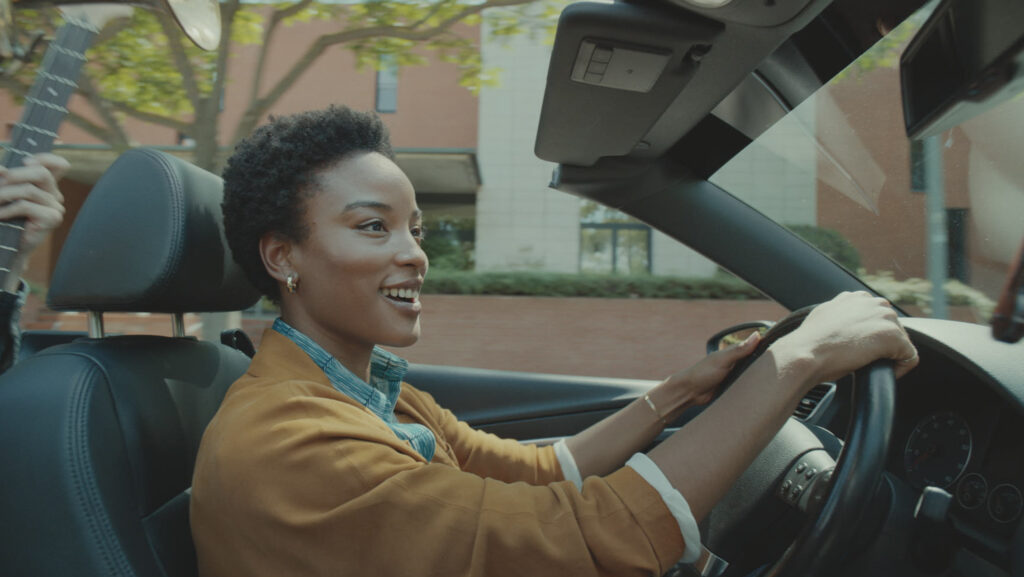 A woman drives a car in Allstate's Everything's Allright ad, featuring